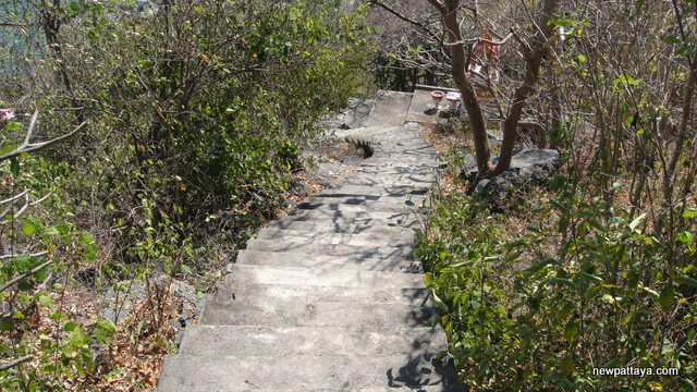 A steep pathway leading to a shrine housing a copy of the Buddha's footprint